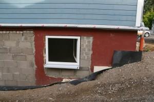 Zugemauerte Türöffnung und verkleinerte Fensteröffnung