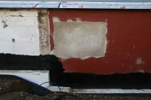 Zugemauerte und verputzte Fensteröffnung