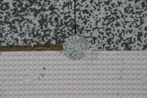 Festgedübelte Dämmung mit Dübelabdeckung